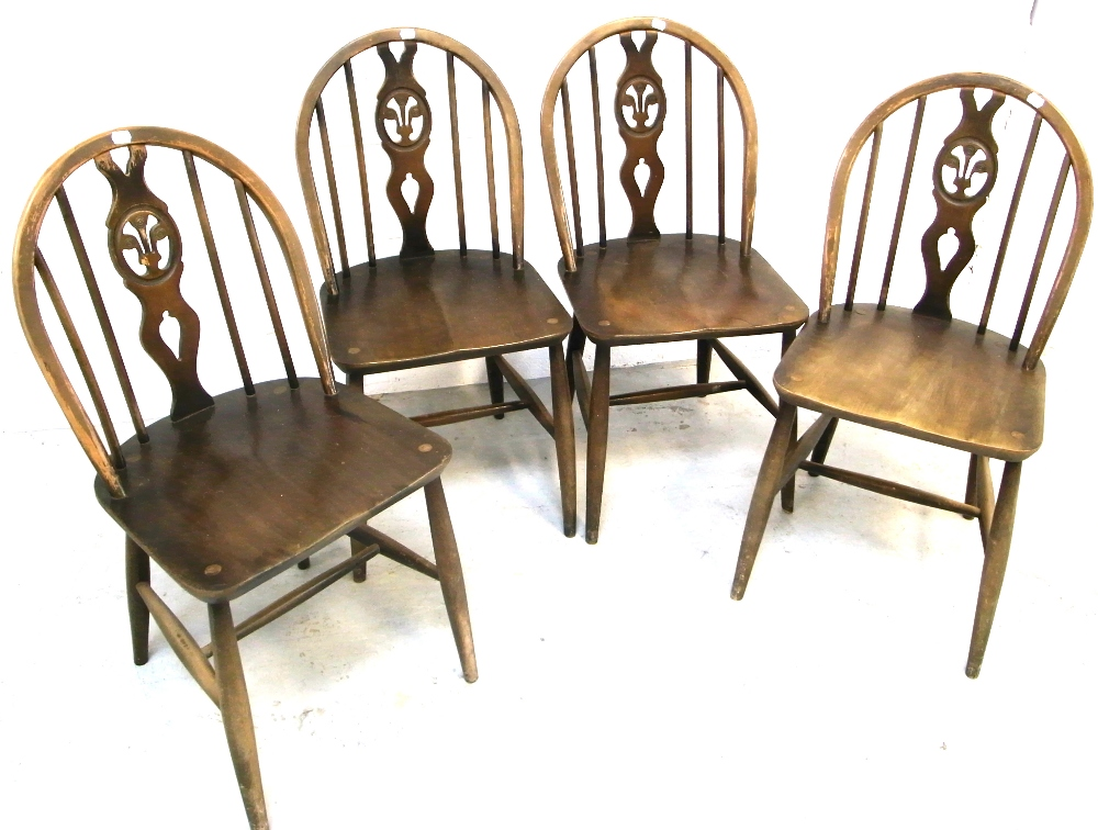 Lot 112 A Set Of Four Ercol Dining Chairs In Fleur De