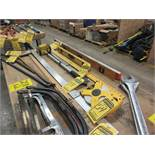 ASSORTED MEASUREMENT DEVICES: T-SQUARE, FRAMING SQUARE, LEVELS, ROLLER TAPE, 100' TAPE