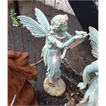 A cast iron standing fairy with bird