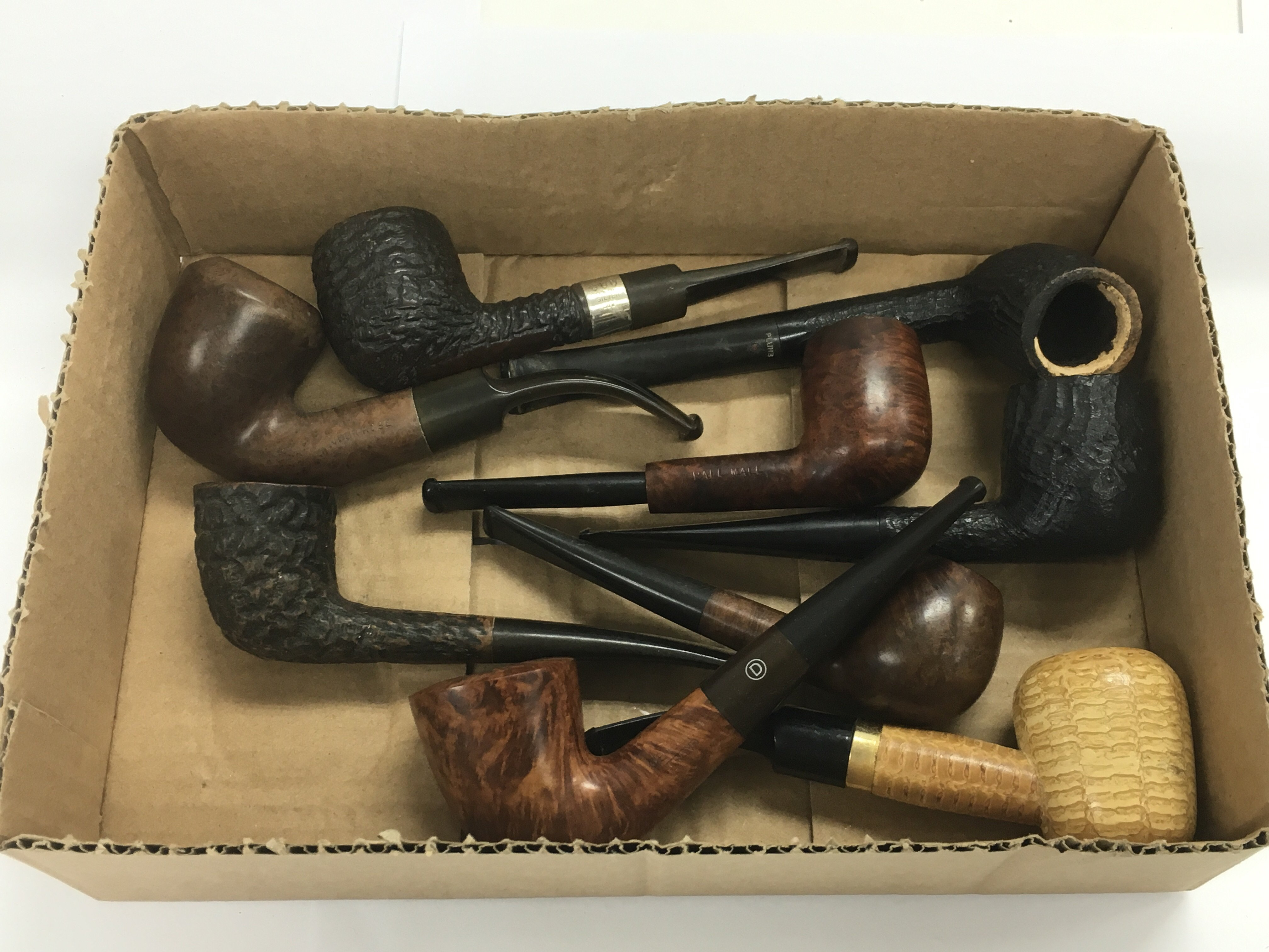Lot 1840 - Nine smoker's pipes including one silver banded ex