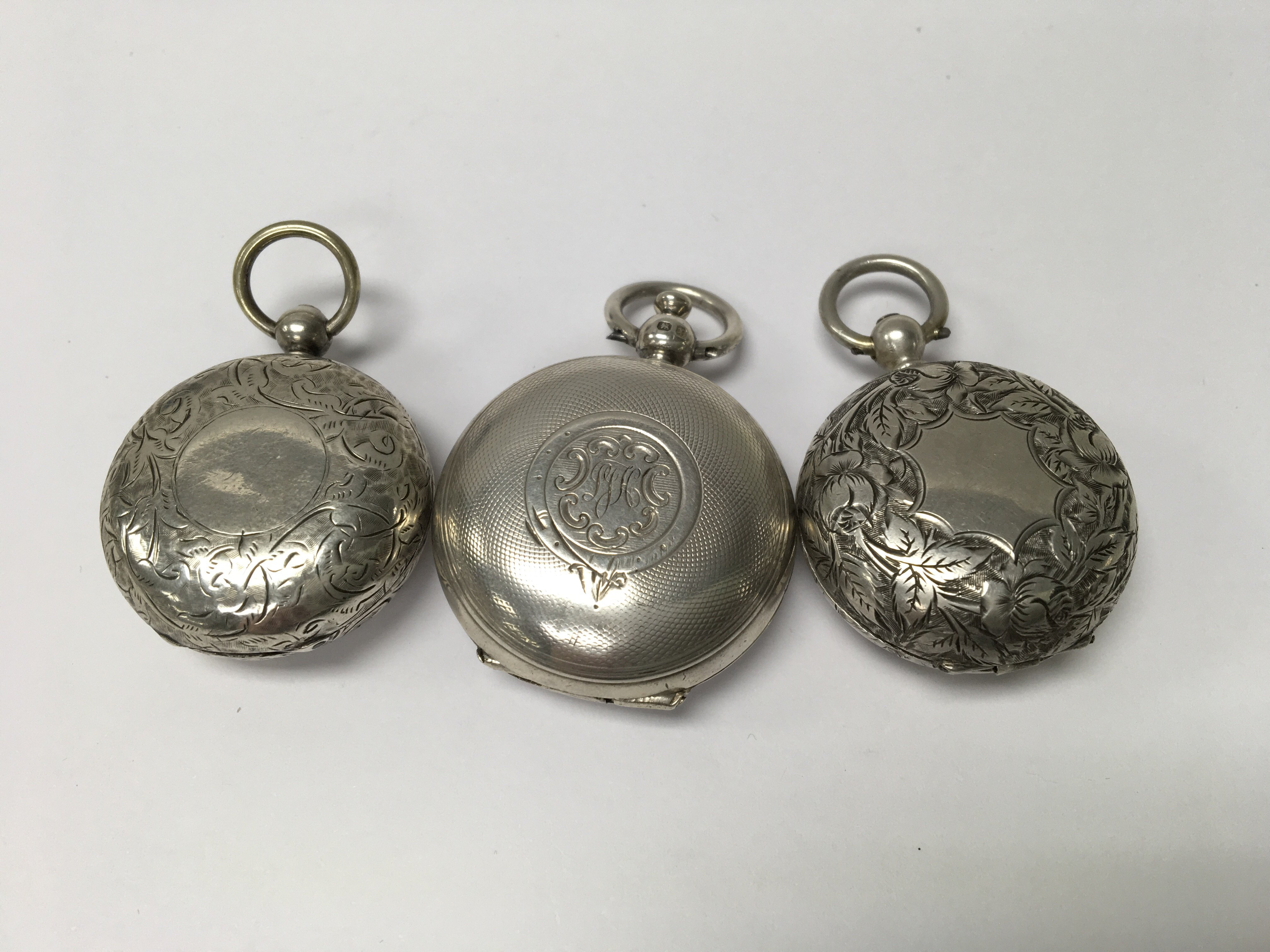 Lot 577 - Two silver sovereign cases and one other