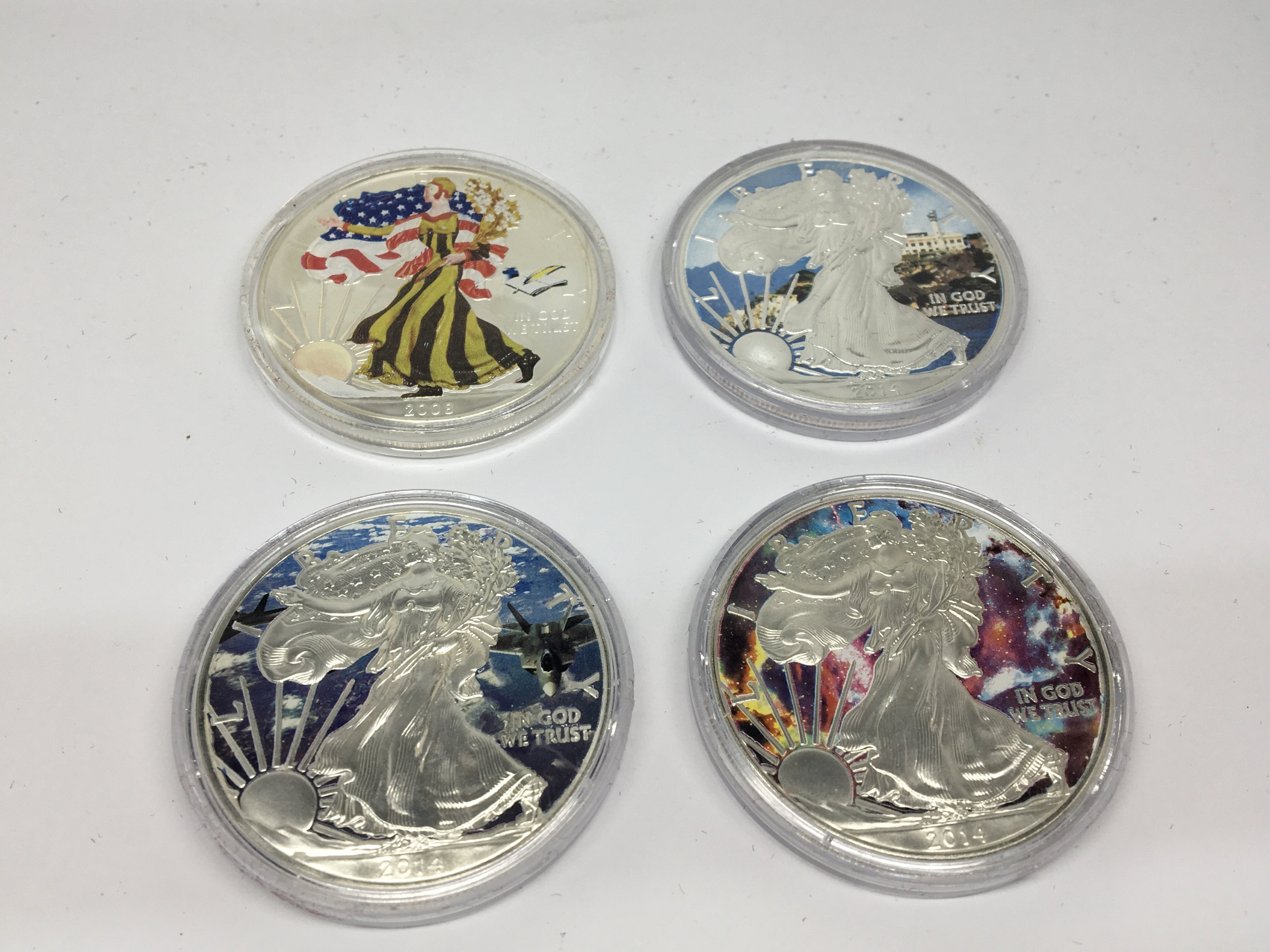 Lot 122 - A Collection of Four American Silver Dollars ename