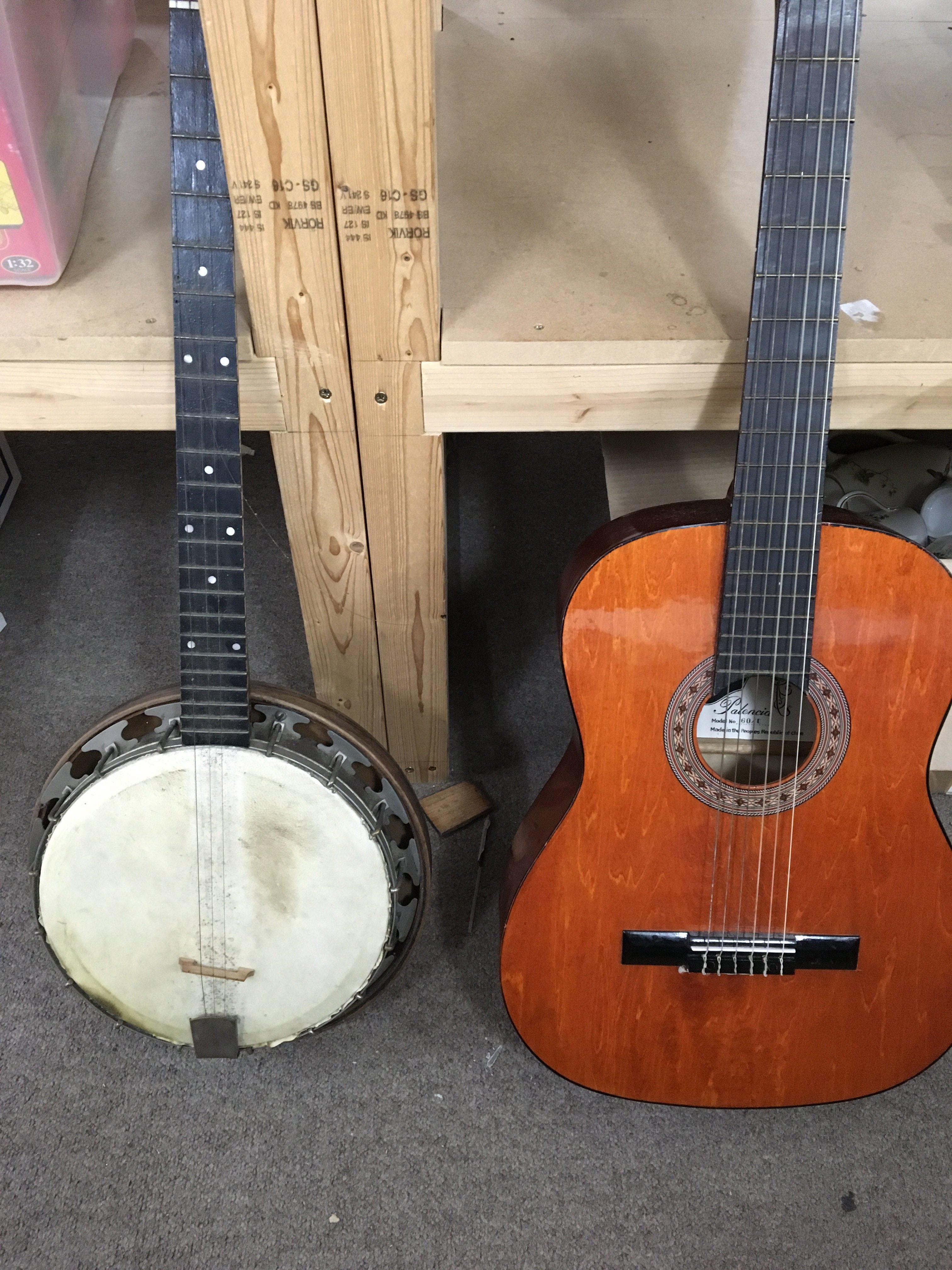 Lot 1874 - A banjo and guitar