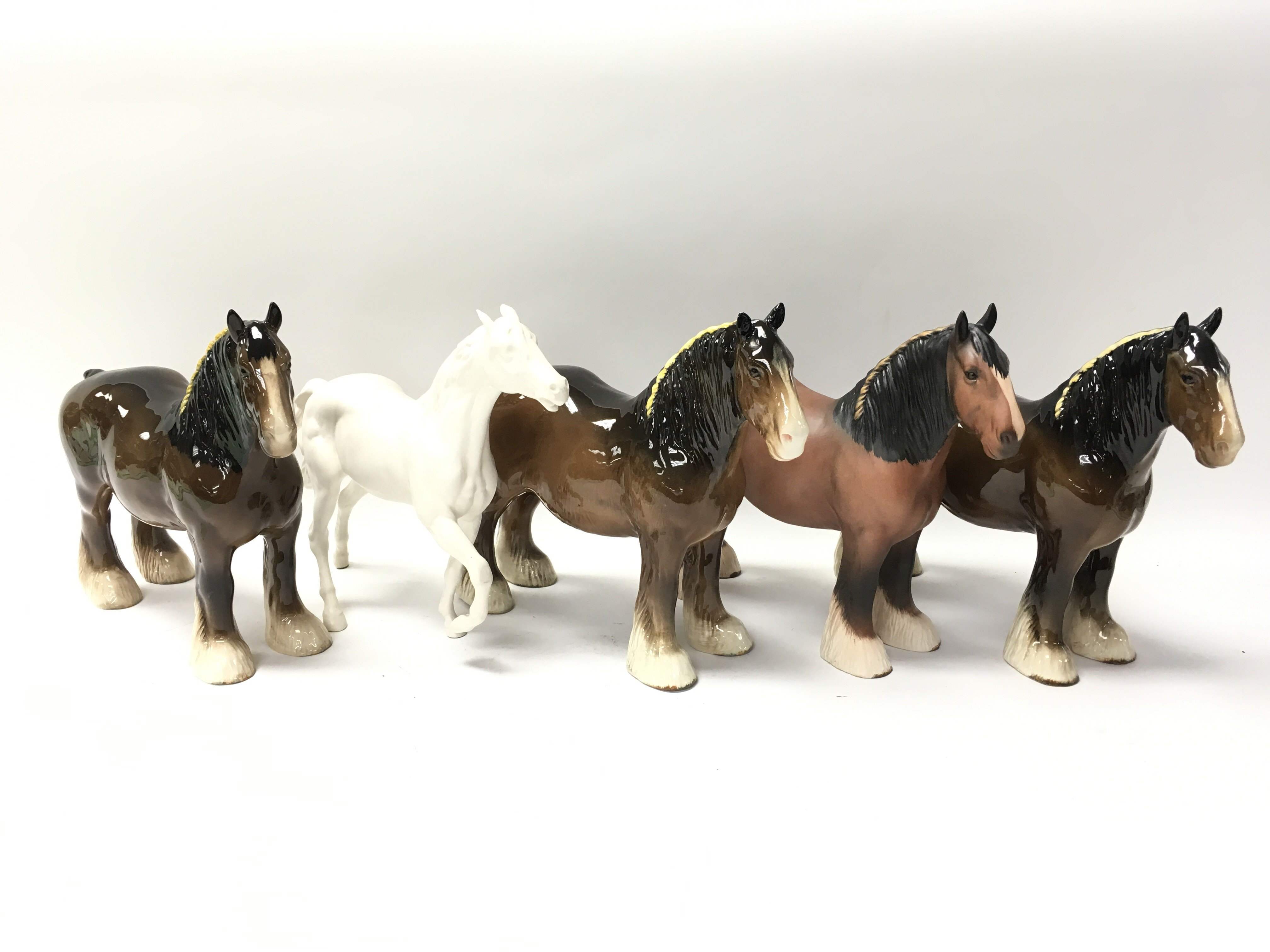 Lot 738 - A collection of five Beswick ornamental horses of