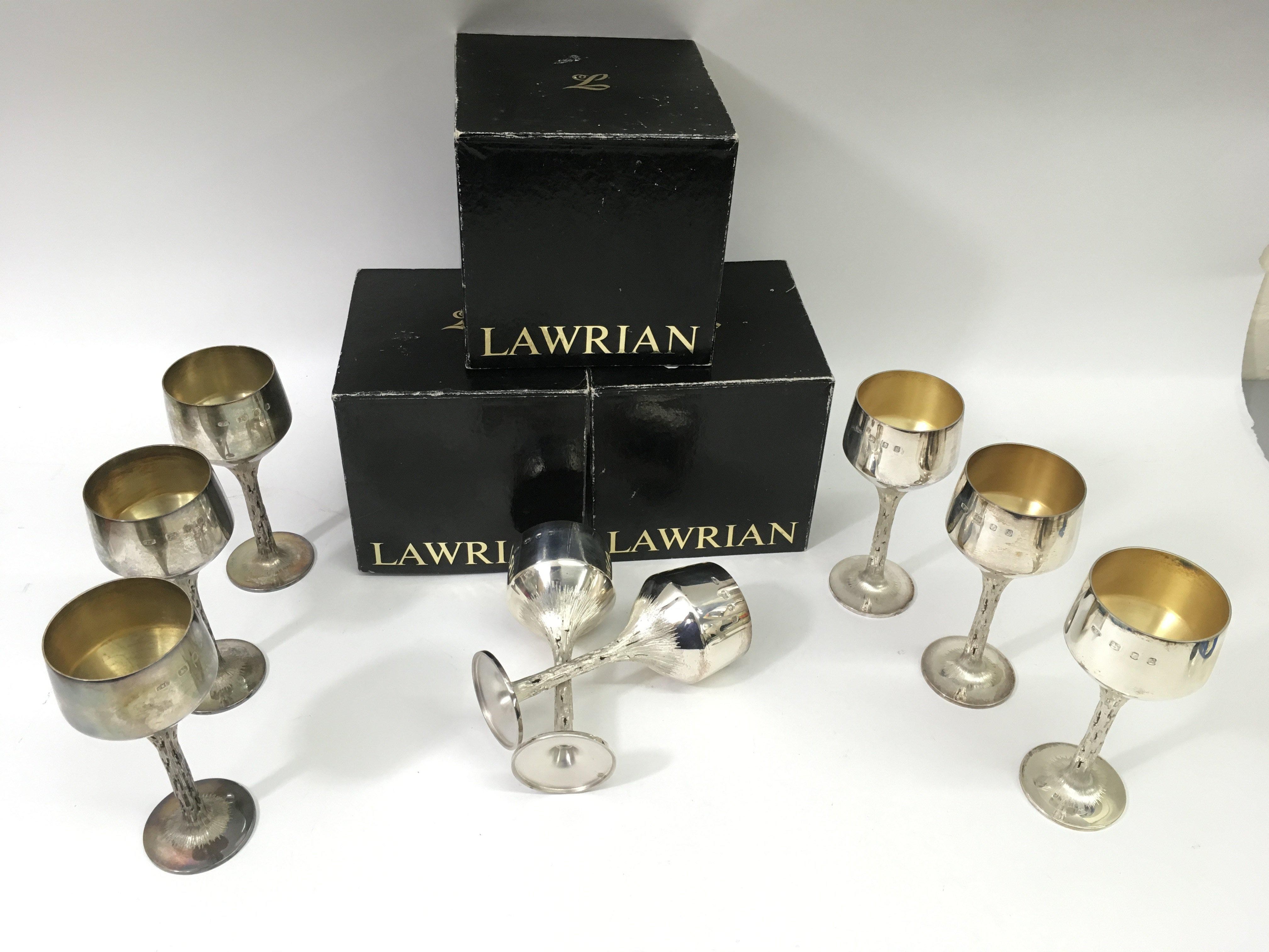 Lot 92 - A fine set of eight Modernist silver goblets by Ch