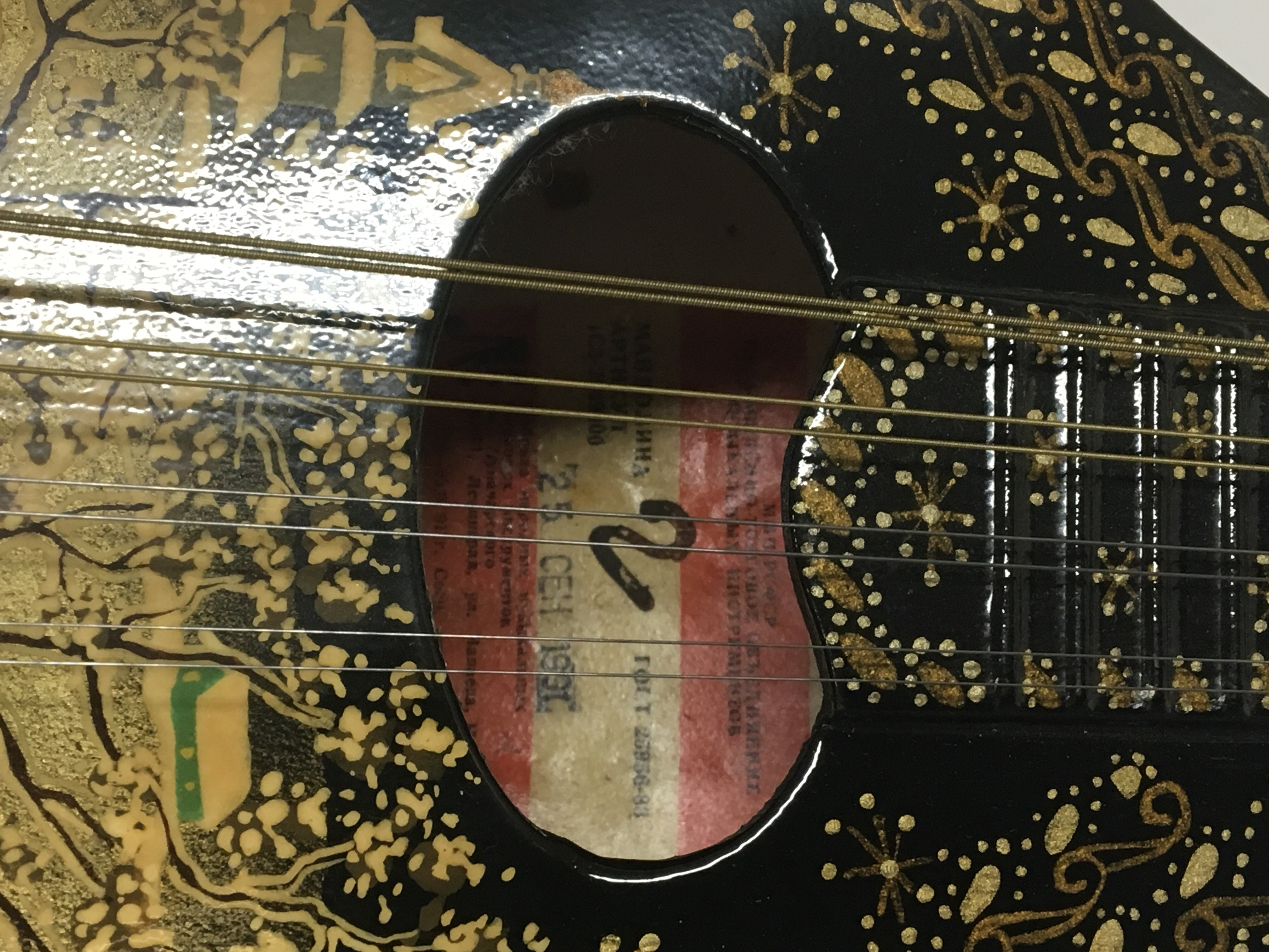 Lot 1835 - A Russian Mandolin type instrument with eight stri