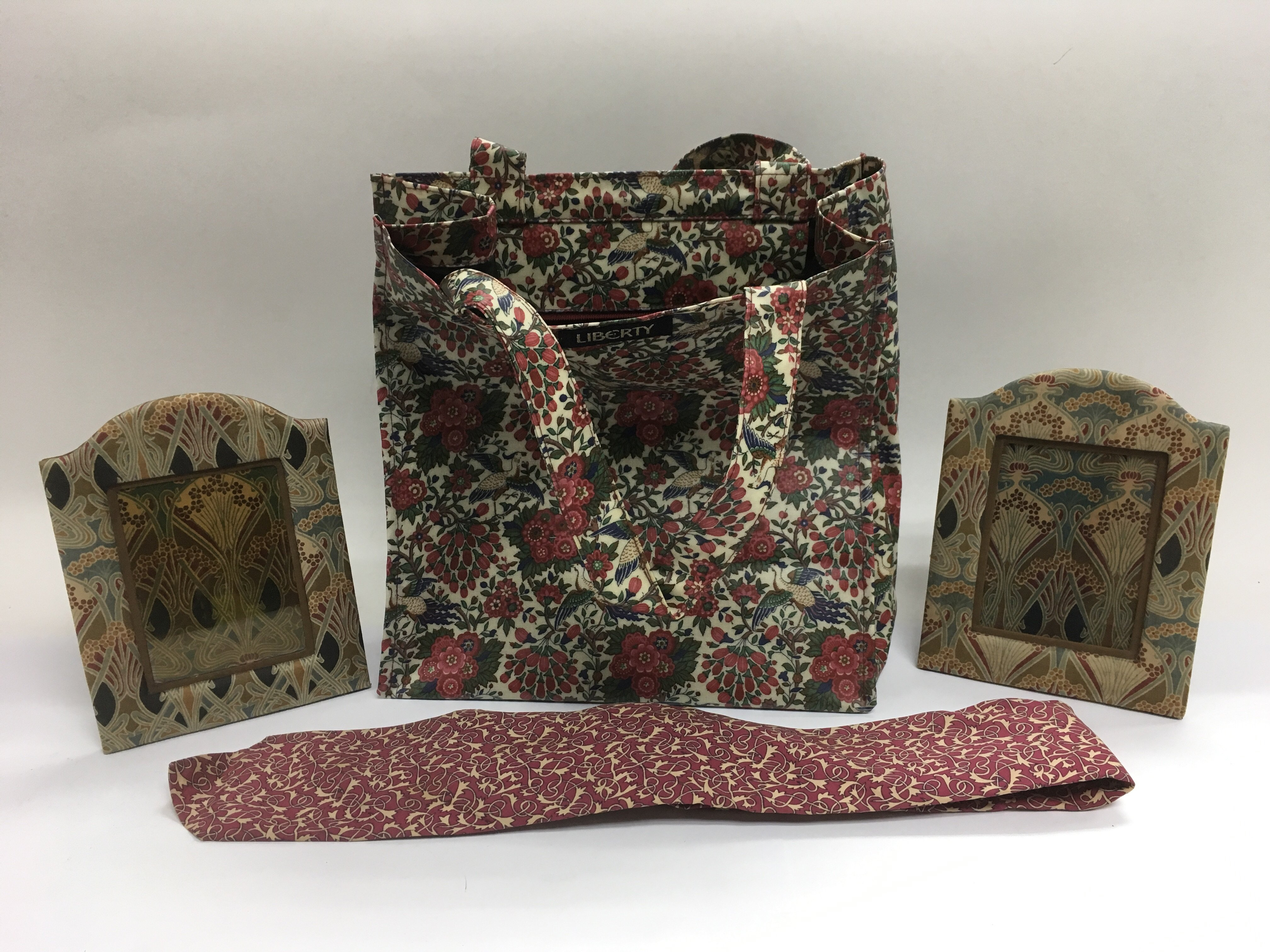 Lot 657 - A Liberty bag, two photograph frames and a neck ti