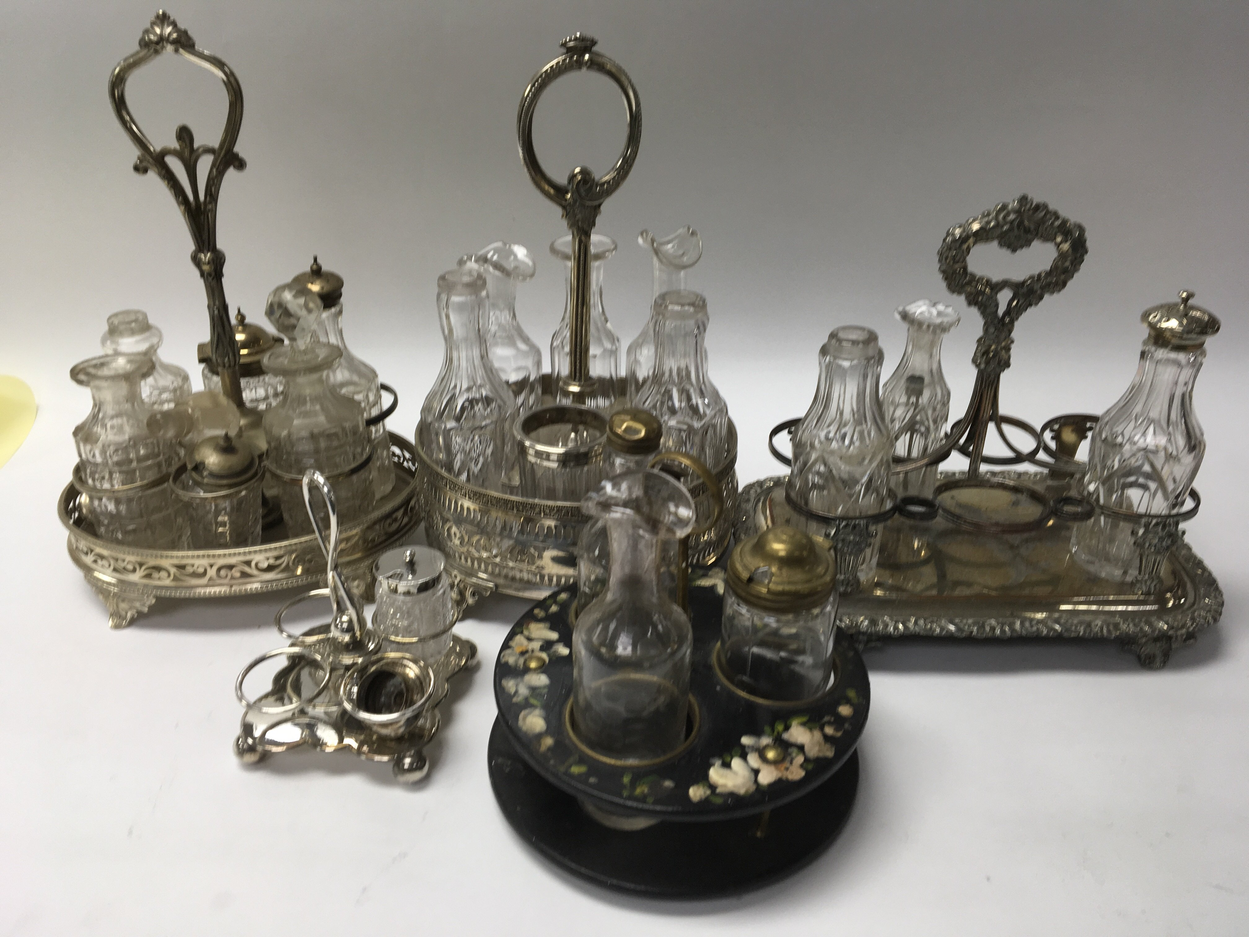 Lot 248 - A collection of silver plated cruets inset with gl
