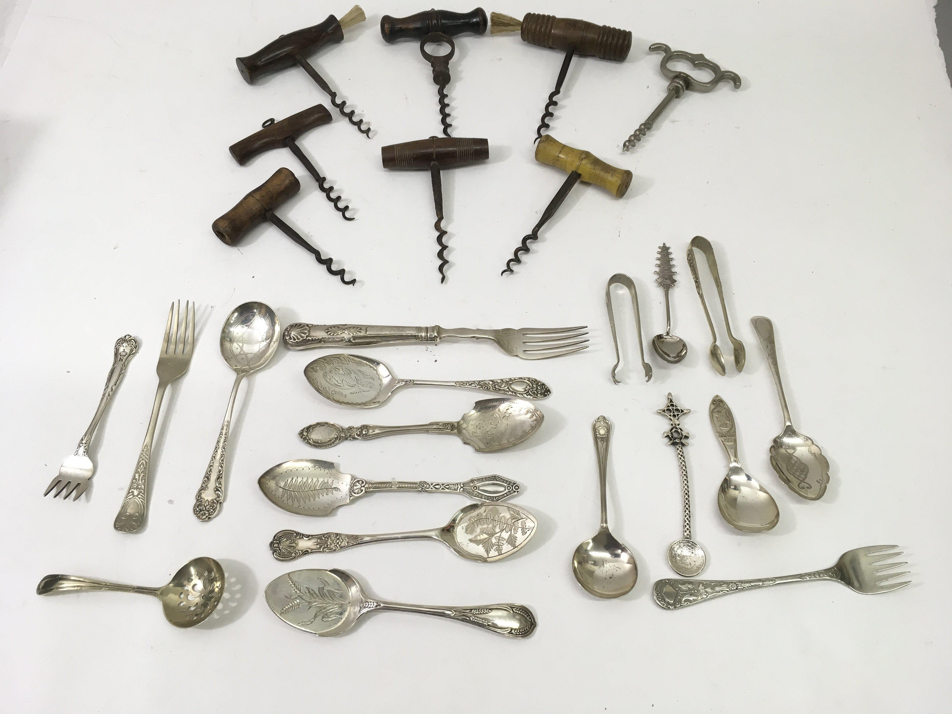 Lot 1817 - A collection of corkscrews and silver plated cutle