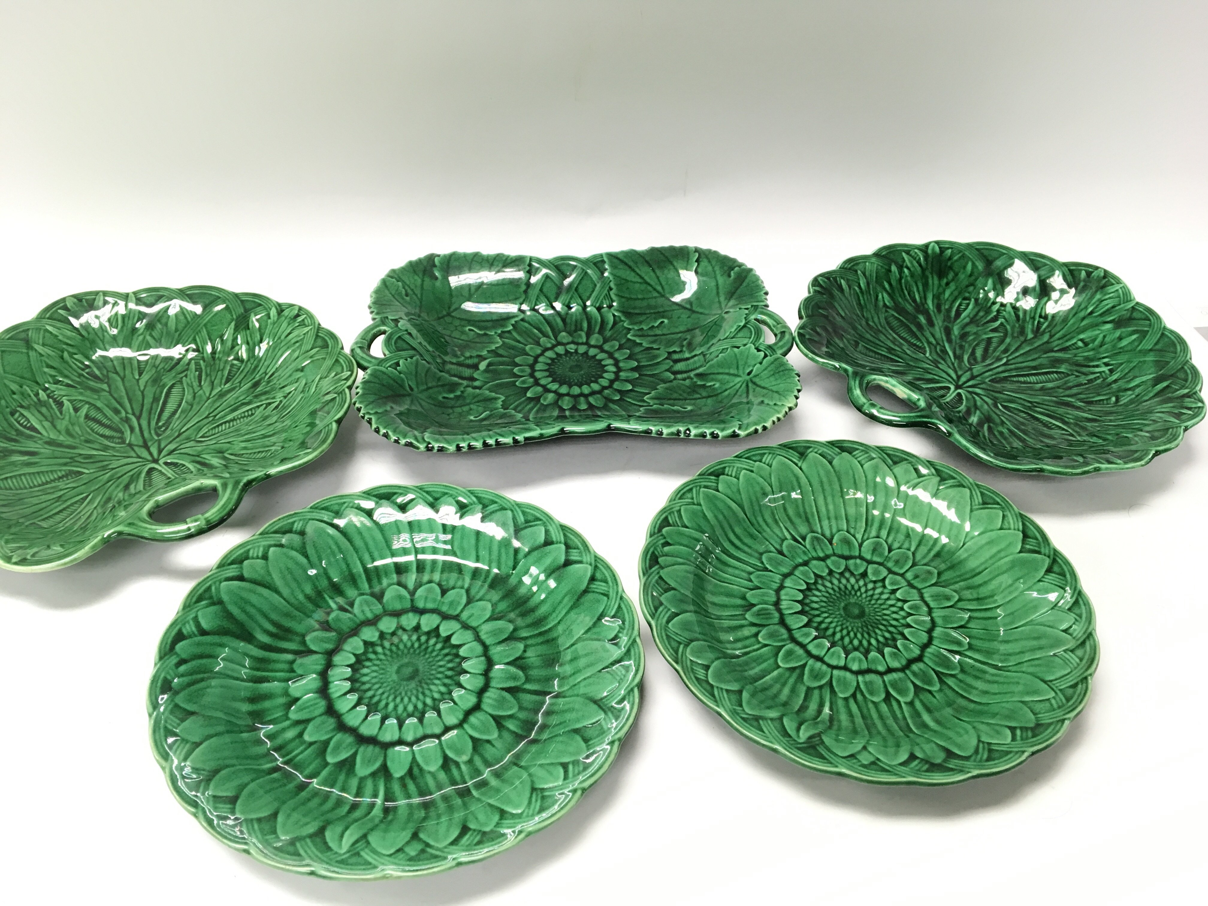 Five Victorian Wedgwood Majolica plates with shape