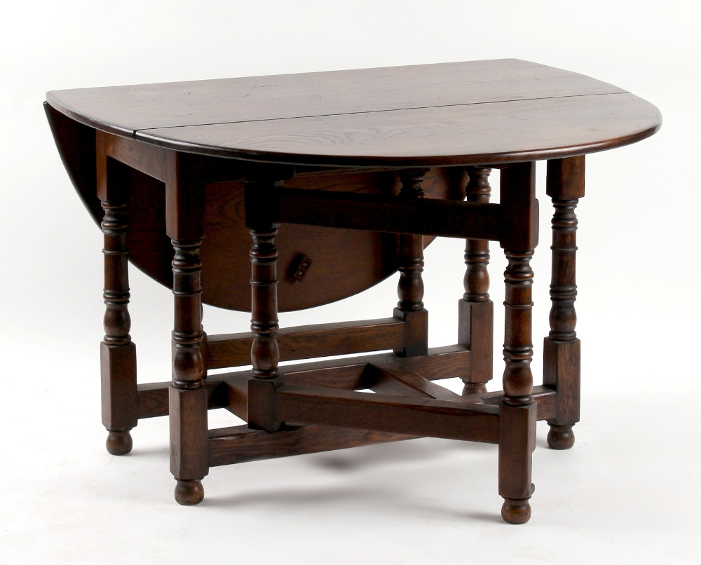 Property of a gentleman - an oak oval topped gate-leg table, with baluster turned supports, 43.
