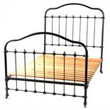 Property of a deceased estate - an early 20th century brass & iron 4' double bedstead (see