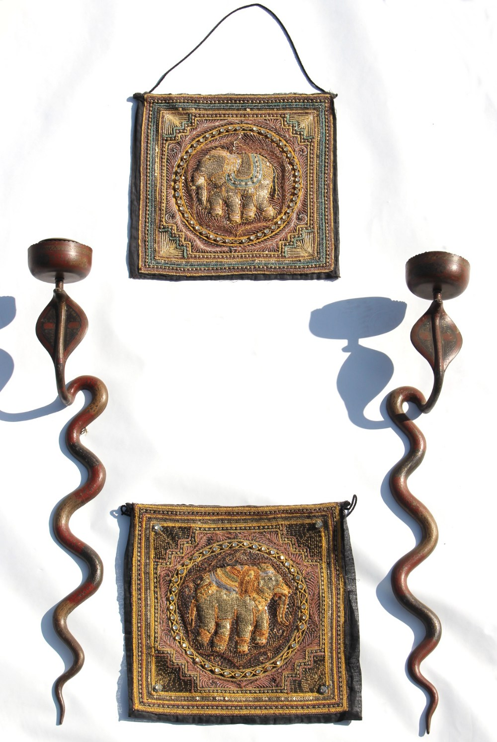 Property of a deceased estate - a pair of Indian brass cobra wall mounted candlesticks or appliques,