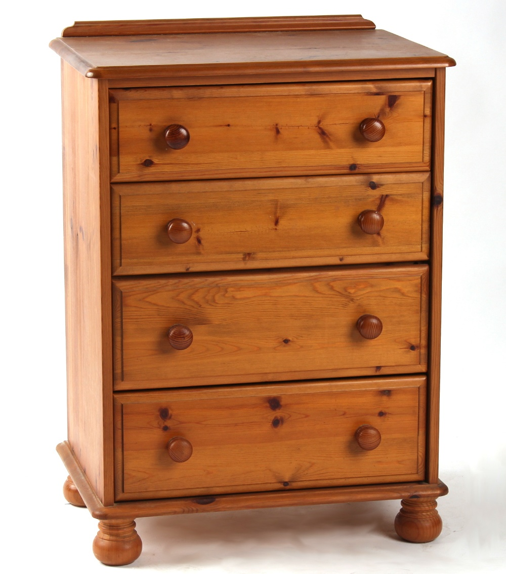 Lot 155 - Property of a deceased estate - a modern pine chest of four long graduated drawers on bun feet, 27.