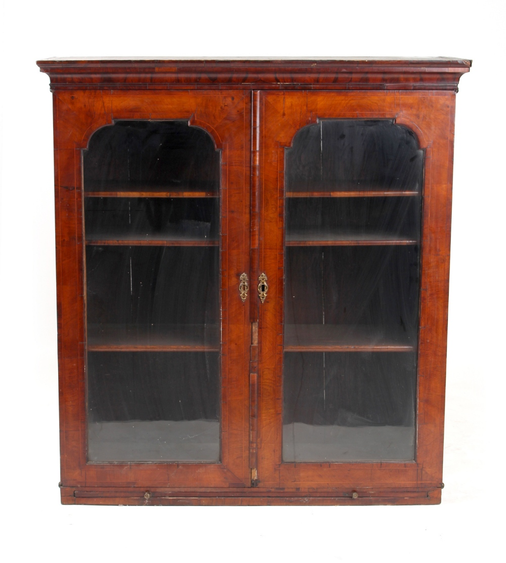 Property of a gentleman - an early 18th century walnut & boxwood strung glazed two-door bookcase top