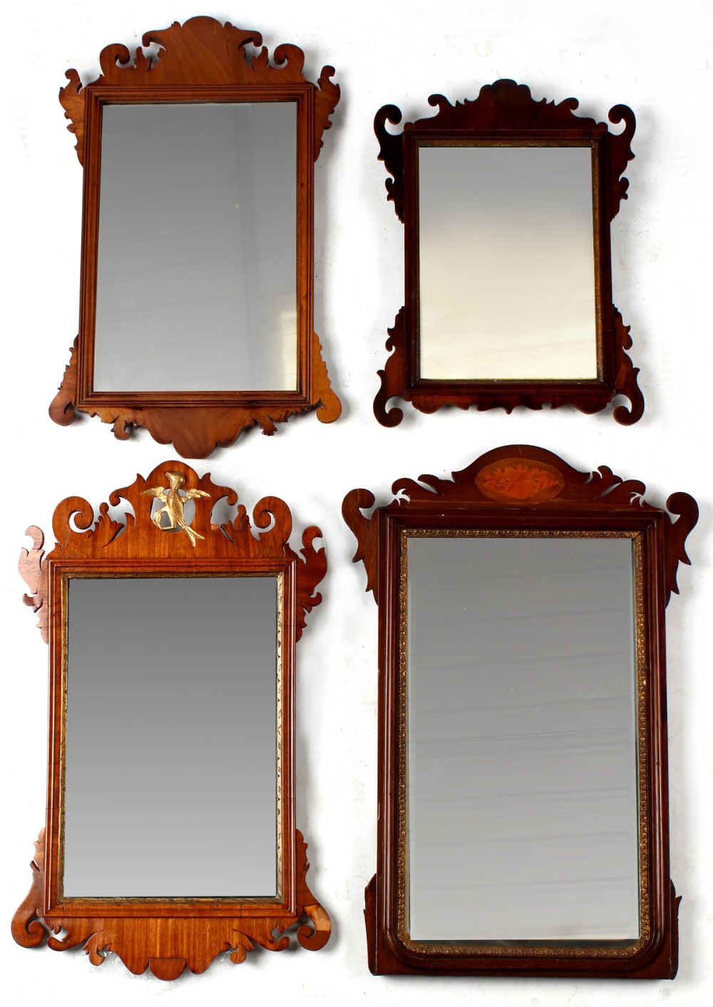 Property of a deceased estate - four 18th century & later mahogany fretwork framed wall mirrors, the