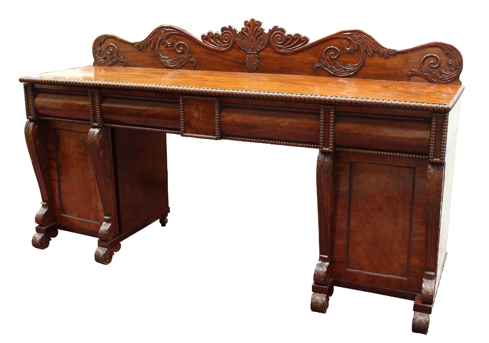 Lot 184 - Property of a lady - a late Regency period mahogany twin pedestal sideboard, with carved low
