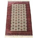 Property of a lady - a Turkoman rug with ivory field, third quarter 20th century, condition very