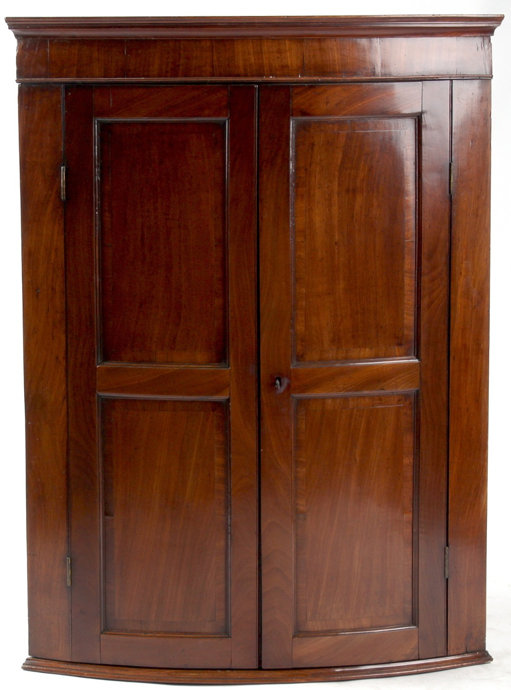 Lot 143 - Property of a deceased estate - a George III mahogany bow-fronted two-door corner wall cabinet,