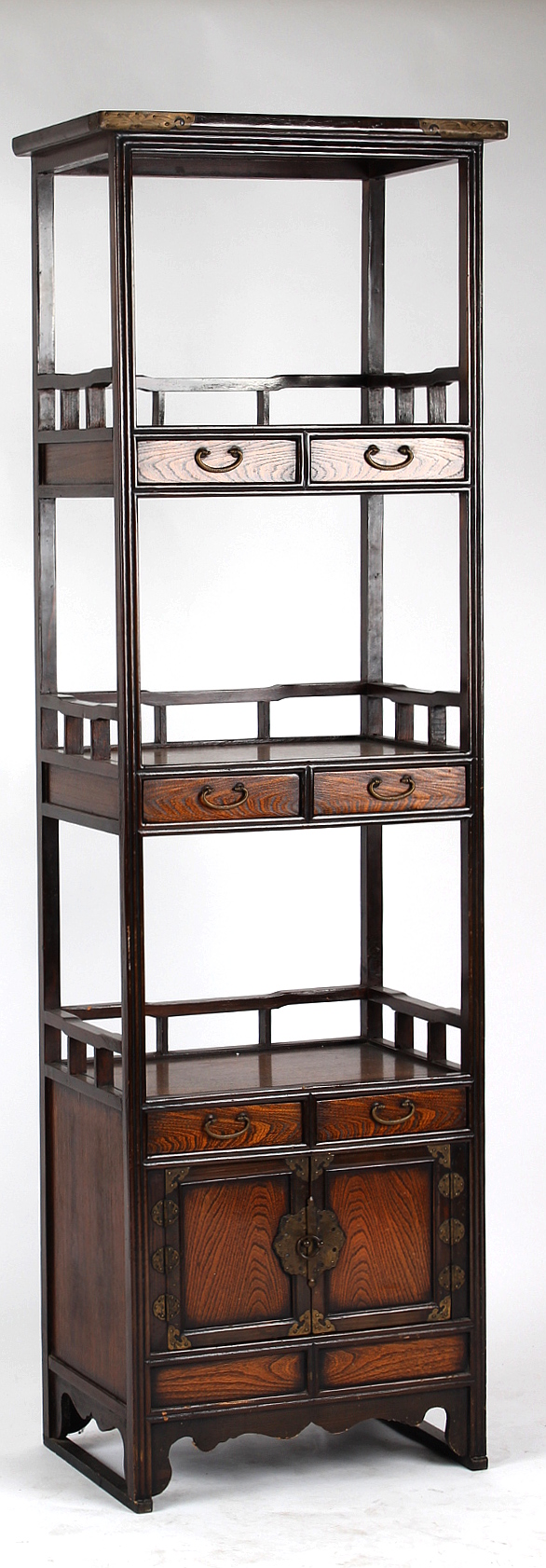 Lot 135 - Property of a deceased estate - a tall Korean elm three-tier open display cabinet fitted with six