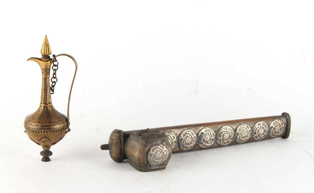 An Islamic damascened scent phial with stopper on chain, bottom of base missing, 4.8ins. (12.