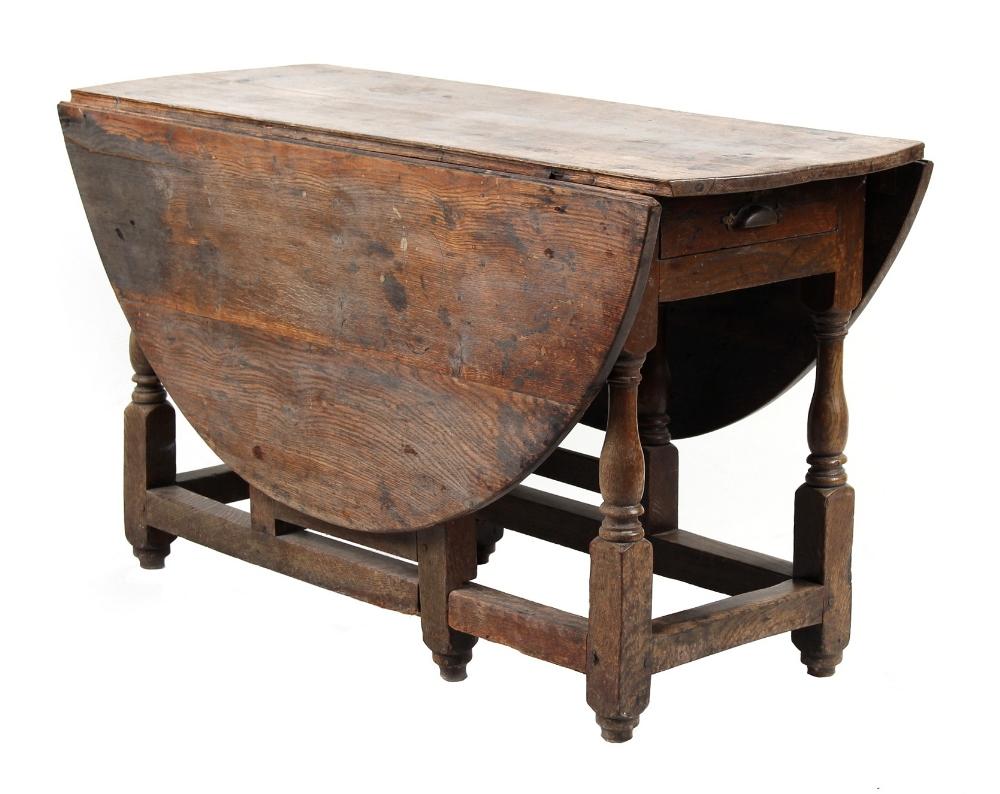 Property of a gentleman - an 18th century oak oval topped gate-leg dining table, with end drawer &