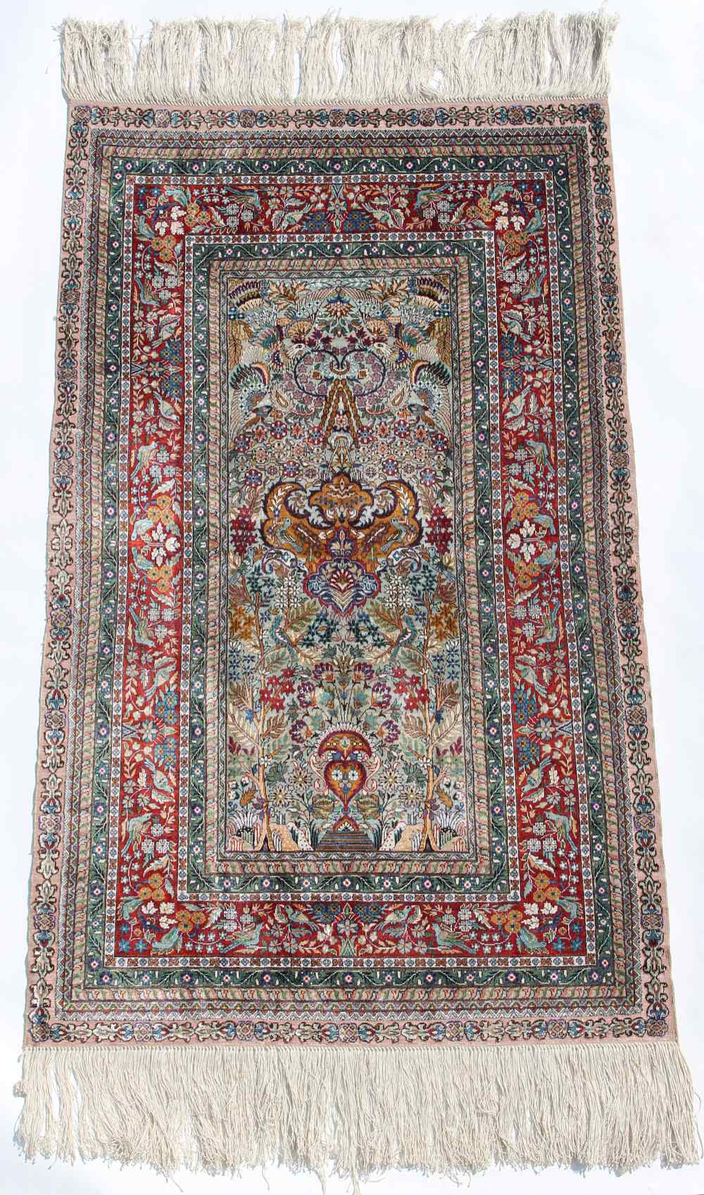 Property of a lady - a fine quality silk prayer rug, 49 by 29ins. (125 by 74cms.) (see