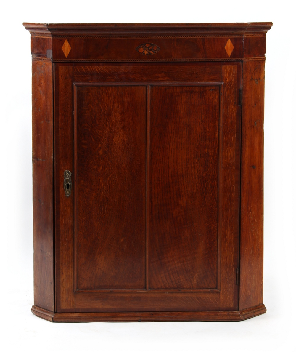 Property of a lady - a George III oak & inlaid corner wall cabinet, 37.4ins. (95cms.) high (see