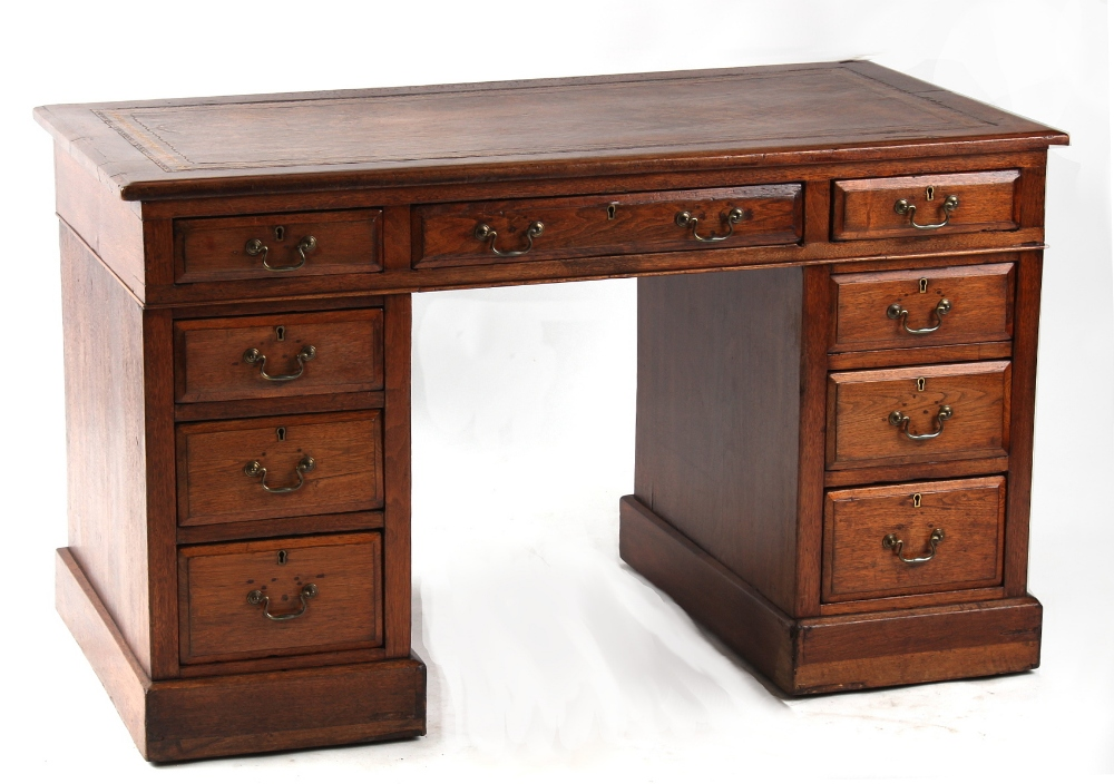 Property of a deceased estate - a small Edwardian twin pedestal desk with brown leather inset top