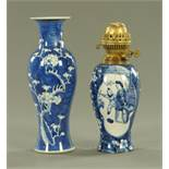 Two Chinese blue and white prunus pattern vases, late 19th century, one of typical baluster form,