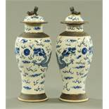 A pair of Chinese crackleware blue and white vases and covers, late 19th century,