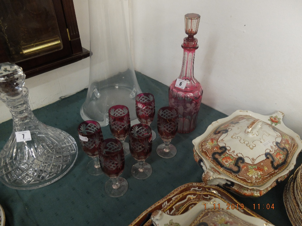 Lot 6 - A cranberry glass decanter and six glasses