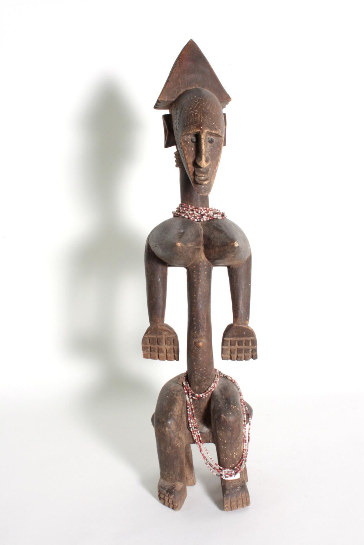 Bambara/Mali, sitzende weibliche Figur, 1. Hälfte 20. Jh.Holz, dunkelbraune Patina, sitzende Frau