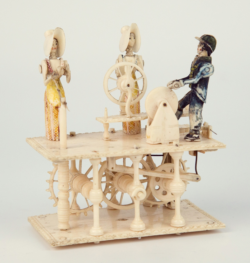 Lot 468 - An early 19th century Napoleonic Prisoner of War spinning jenny bone automaton, French, with two