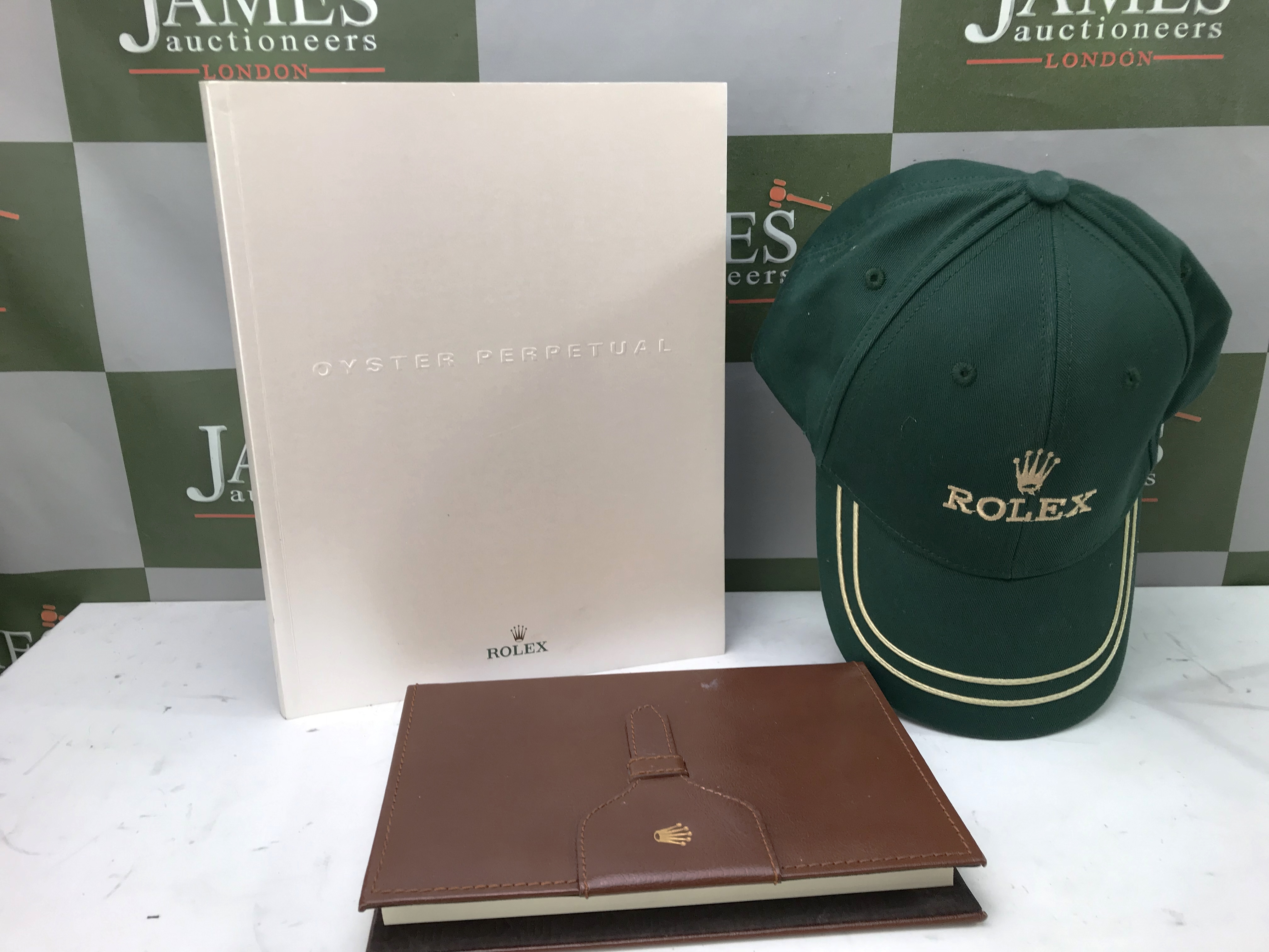 Lot 19 - Rolex Leather Notebook, Cap + 100 Page Oyster Perpetual Book