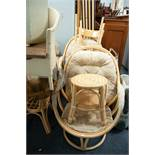 A PAIR OF ROTATING BAMBOO CONSERVATORY CHAIRS, A MATCHING GLASS TOP TABLE AND FOOTSTOOL, A PAIR OF