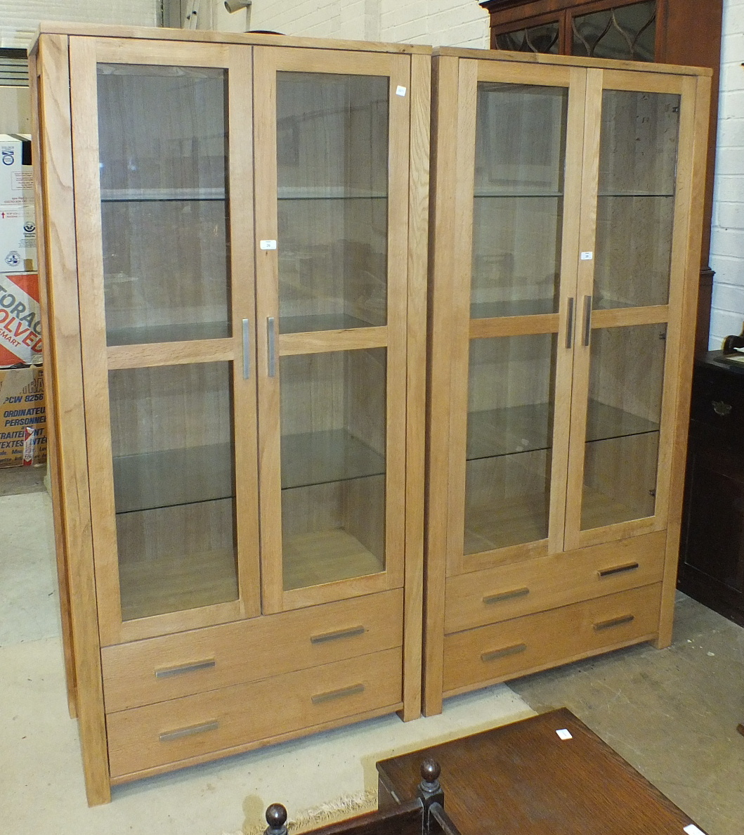 Lot 26 - A pair of modern Oaklands Furniture oak display cabinets, each fitted with a pair of glazed doors