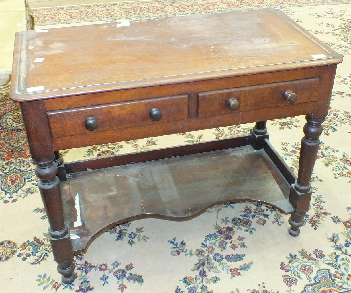 Lot 1 - A late-Victorian mahogany wash stand, the rectangular top above two frieze drawers, on turned legs