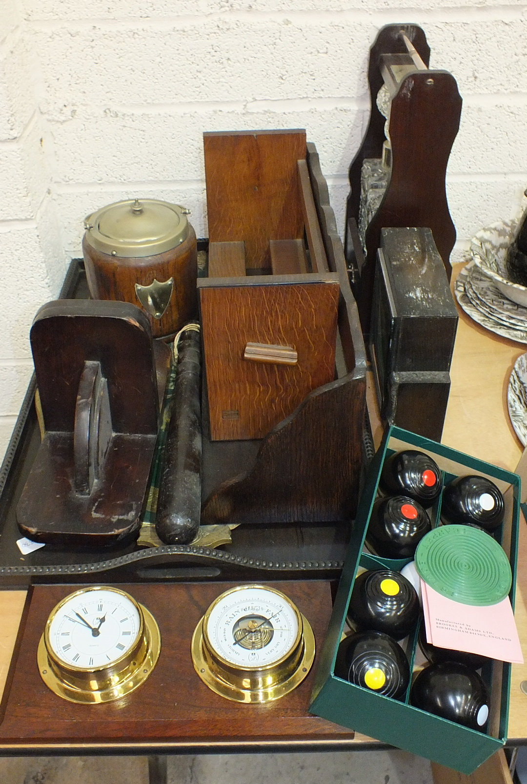 Lot 75 - A wooden truncheon, a set of B&A carpet bowls, a modern two-bottle Tantalus and other wooden items.