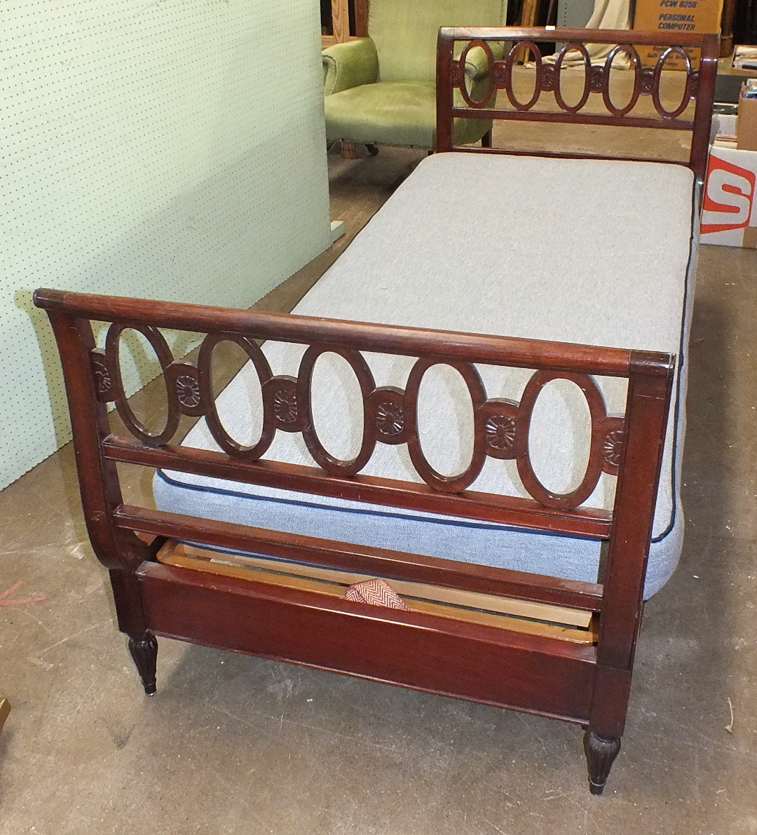 Lot 39 - A French mahogany day bed with pierced ends and short turned legs, with sprung horsehair mattress,