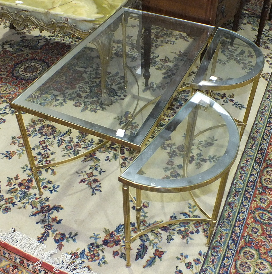 Lot 41 - A modern brassed frame rectangular coffee table with glass top, 85.6 x 48.5cm, 47.5cm high, a pair