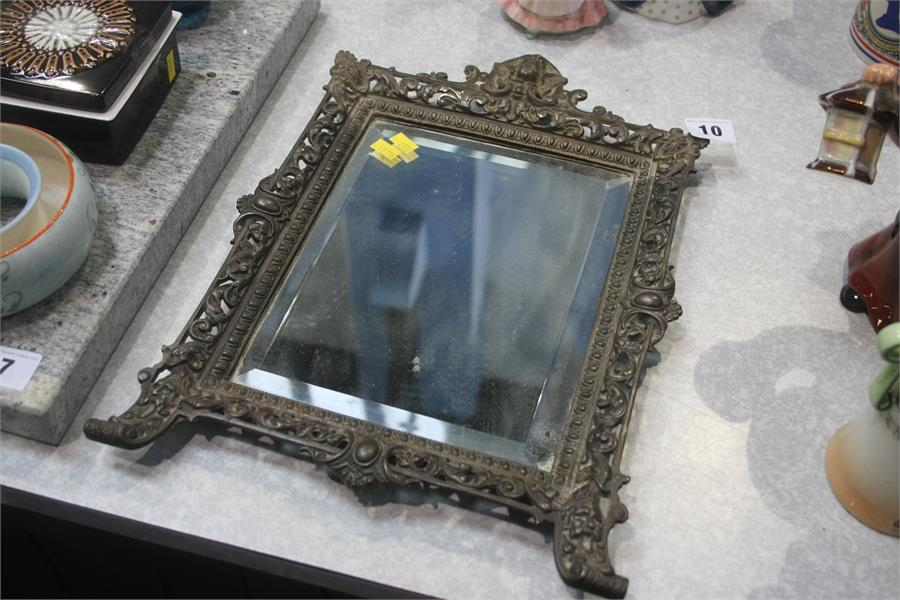 Lot 10 - Mirror in ornate cast frame