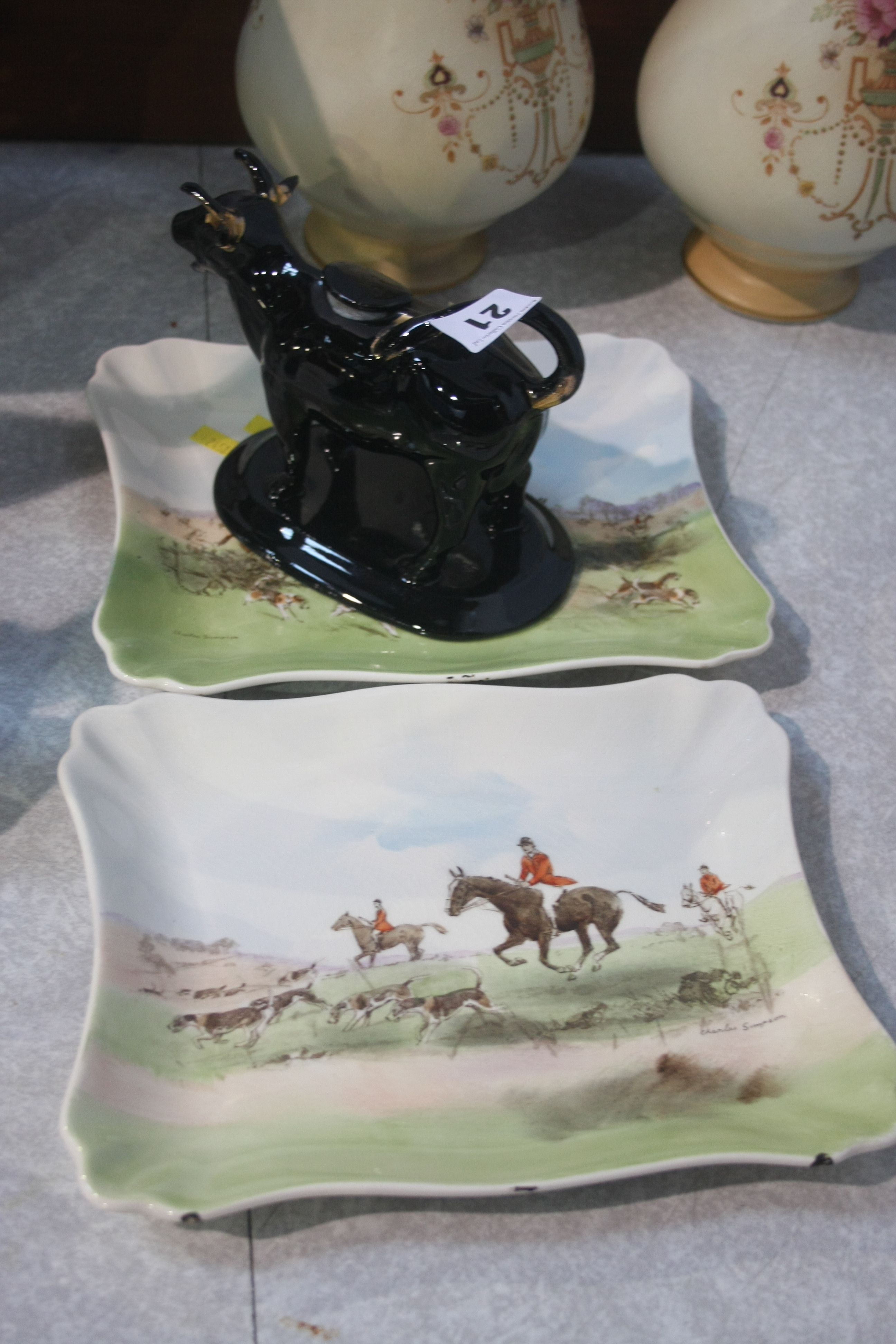 Lot 21 - Staffordshire cow creamer and two Royal Doulton pl