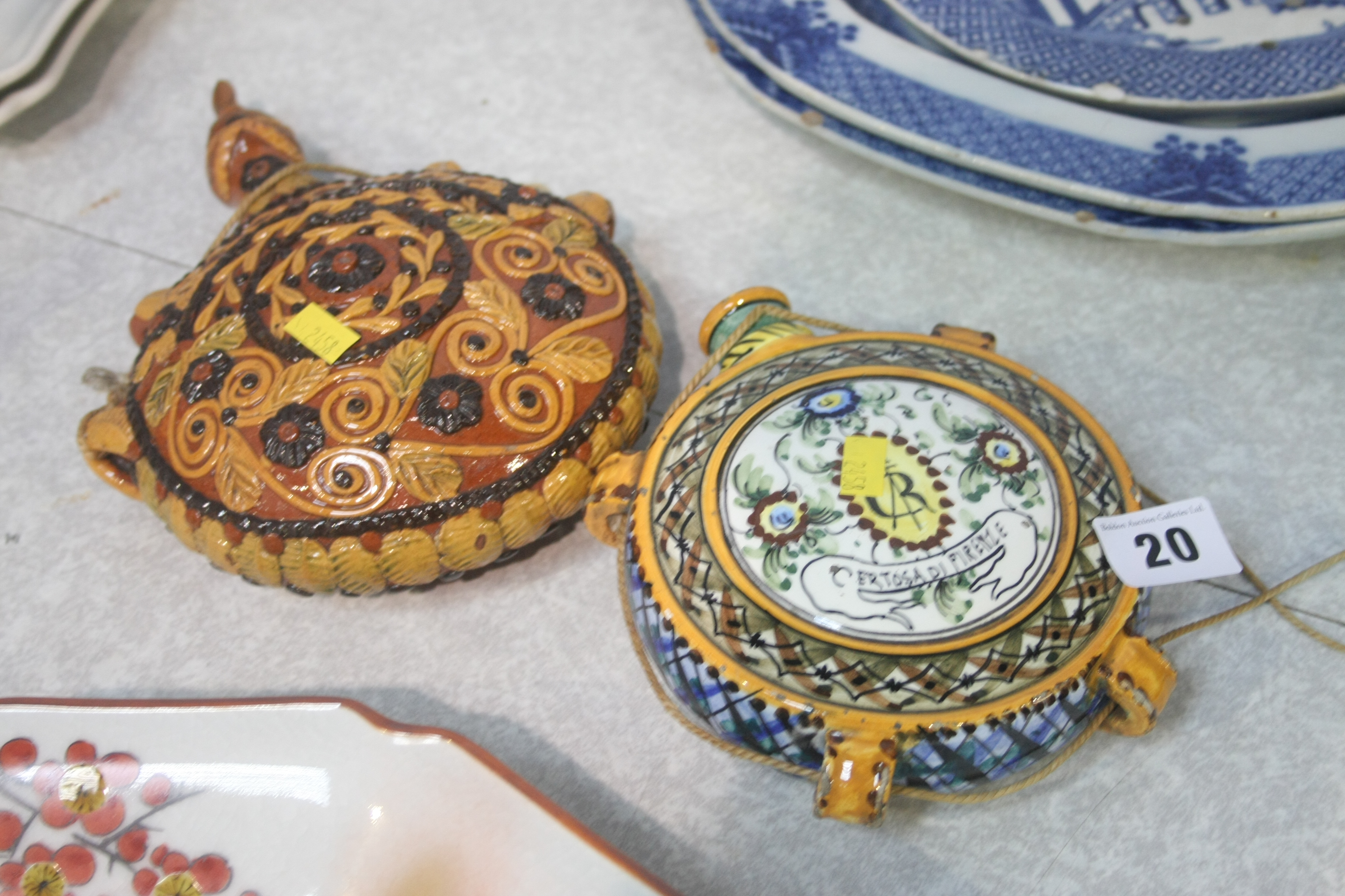 Lot 20 - A Majolica flask and one other