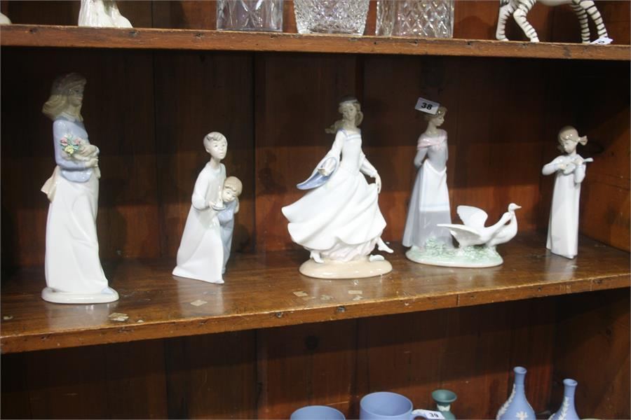 Lot 38 - Four Lladro figures and one other (5)
