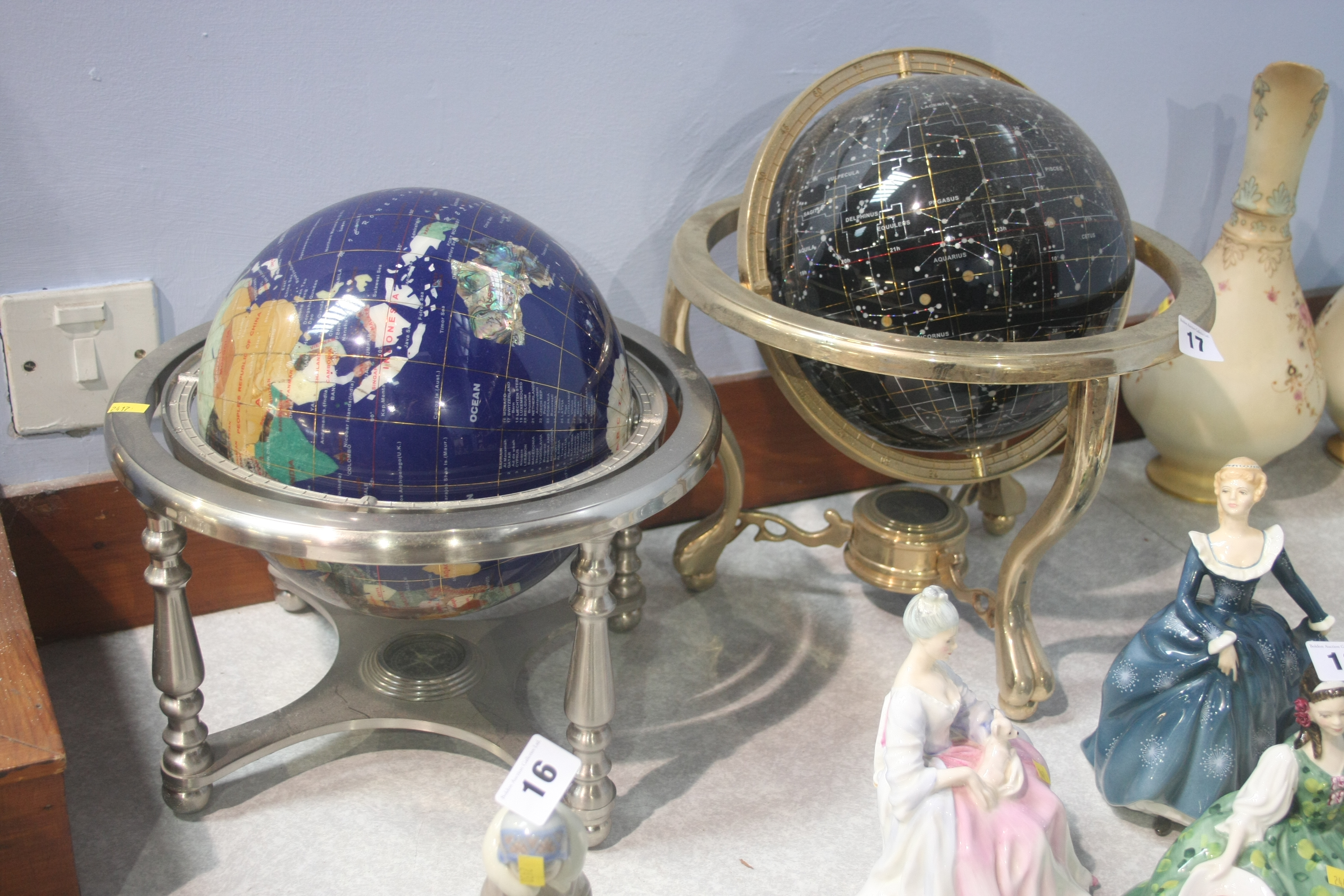 Lot 17 - Two globes inset with semi precious stones
