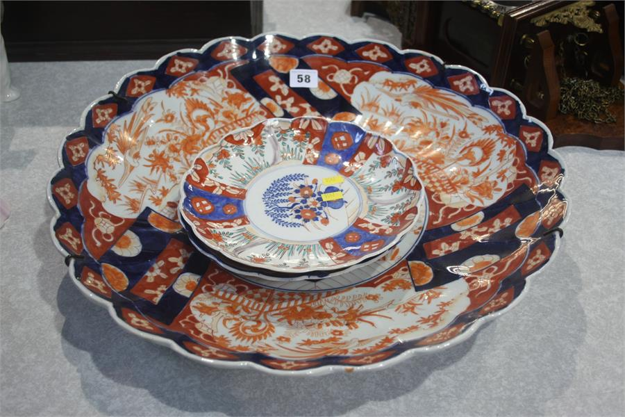 Lot 58 - Large Imari charger and two plates