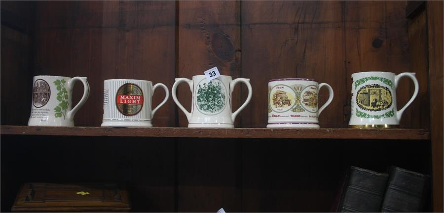 Lot 33 - Five Wade Vaux tankards