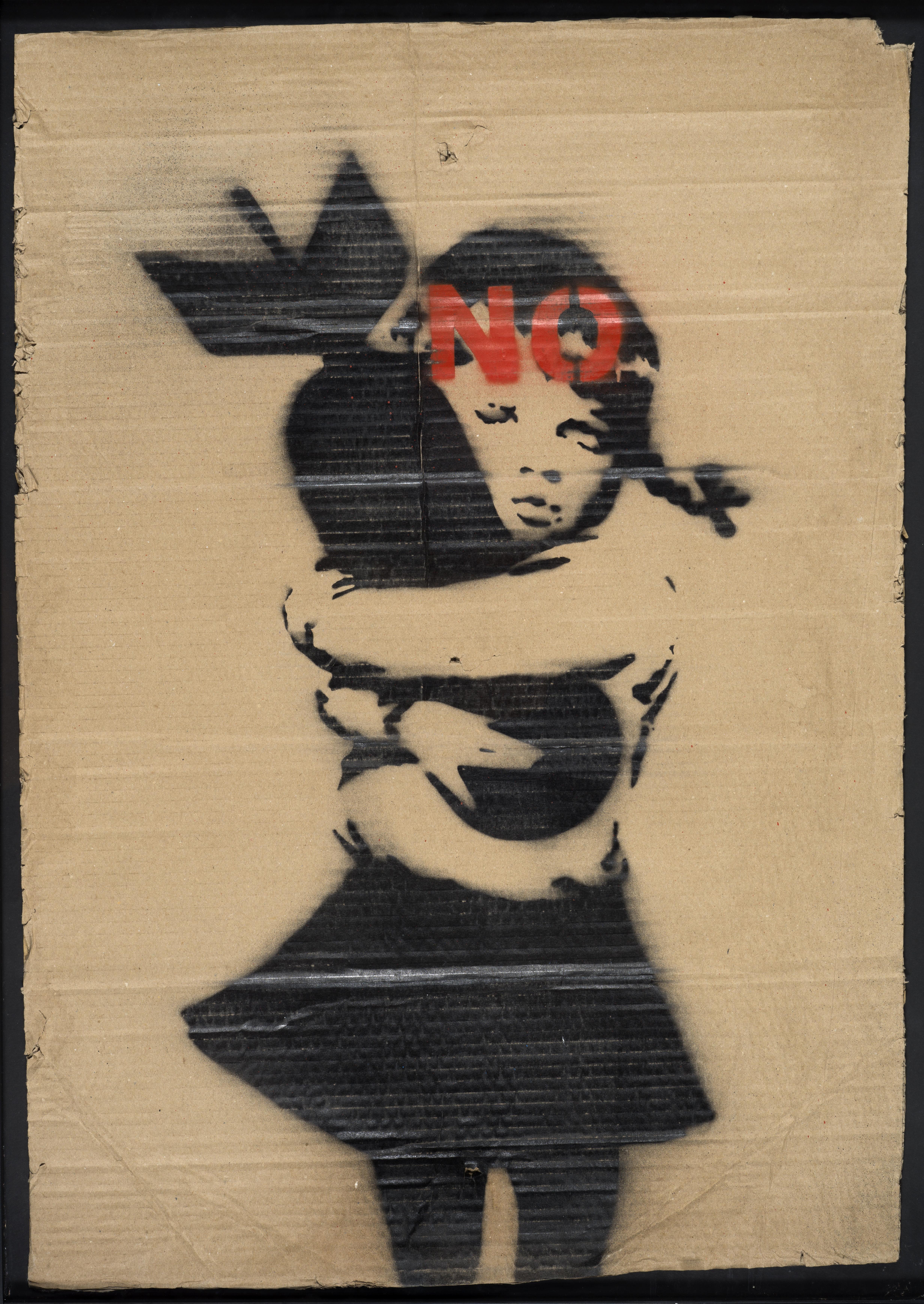 Lot 19 - BANKSY (1974) - Bomb Hugger, No, 2003 - Aérosol et pochoir sur carton - 78 x 55 cm [...]