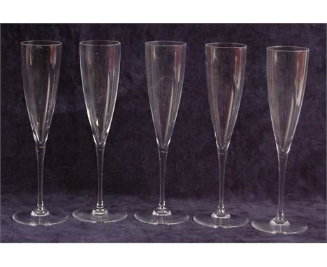 A set of five Baccarat crystal glass champagne flutes, of plain tapering long stemmed form, each with acid etched marks verso